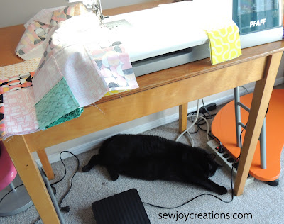 cat in sewing room chain piecing