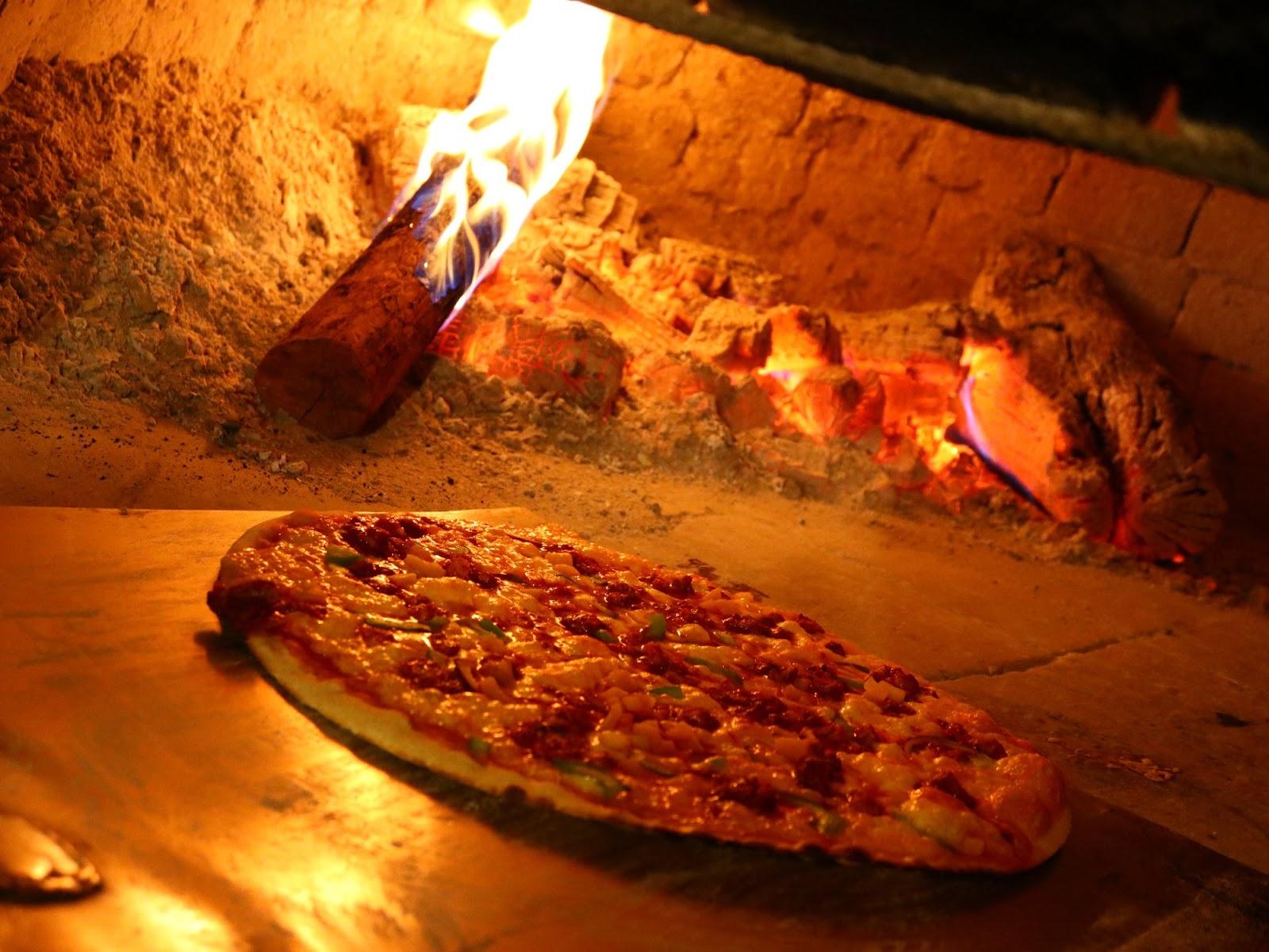 Si comes pizza a la leña ayudas al Medio Ambiente