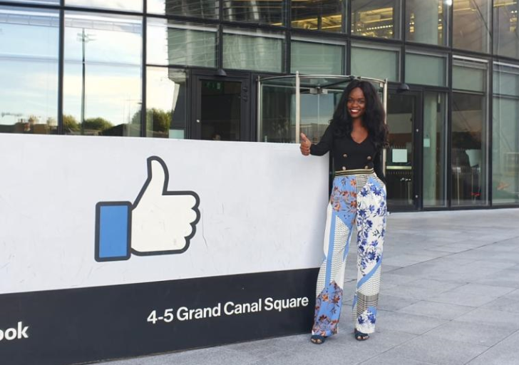 Woman standing in-front of Facebook HQ