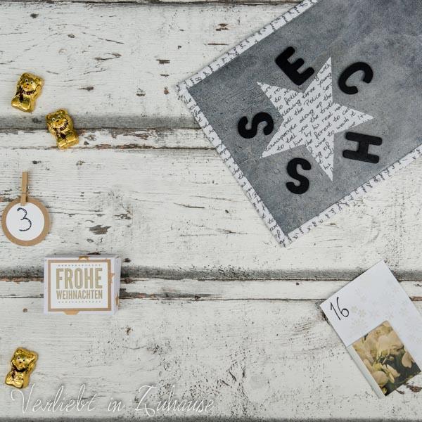 Selbst gebastelte Geschenkbox aus Papier. Ein Wende-Rug-Mug mit Stern und Anleitung. Ein praktischer Lesezeichen-Magnet.