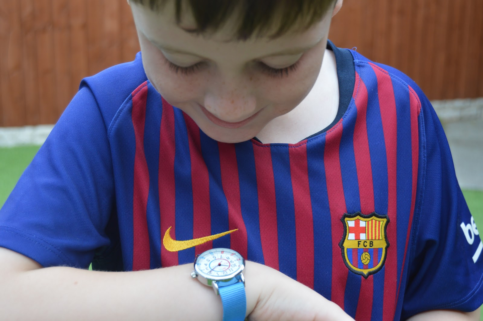 Boy looking at his watch