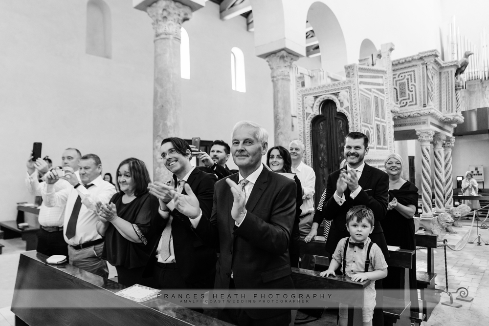 Guests applauding at wedding ceremony