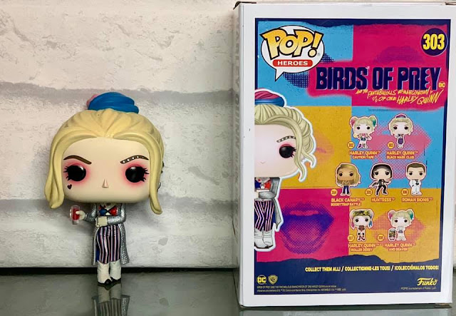 Harley Quinn Funko Pop! Heroes figure next to box with other birds of prey characters