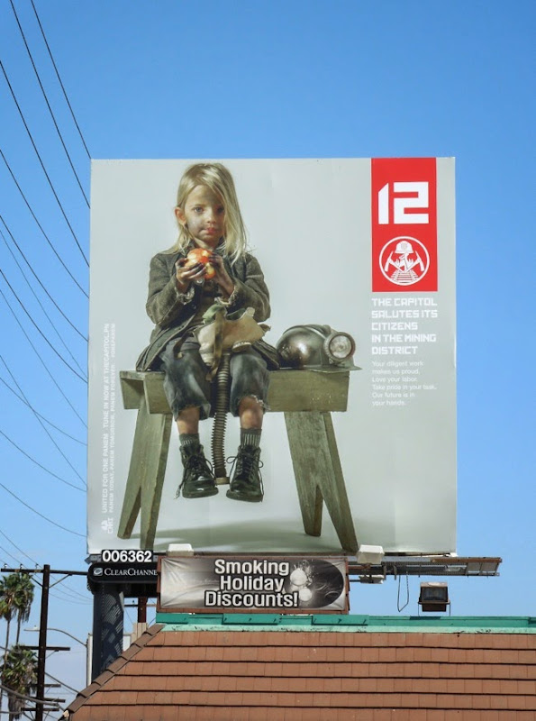 Hunger Games Mockingjay Part I District 12 propaganda teaser billboard