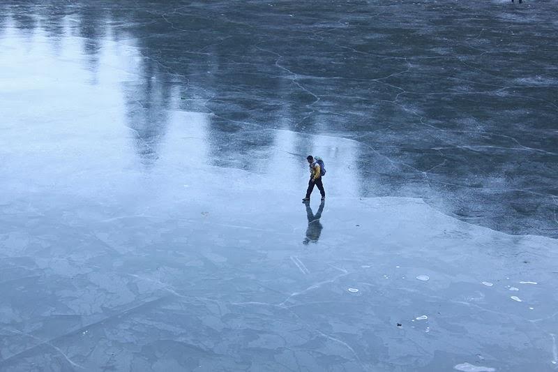 person walking on frozen lake