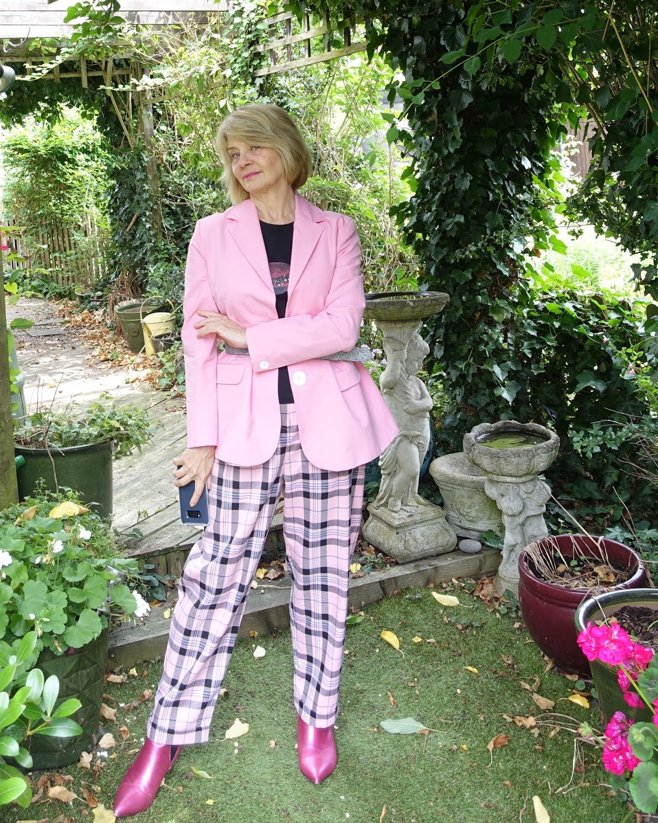 Style blog Is This Mutton featuring pink, black and white check trousers worn with pink and black to show that women over 50 can get away with checks and not just in the form of kilts.
