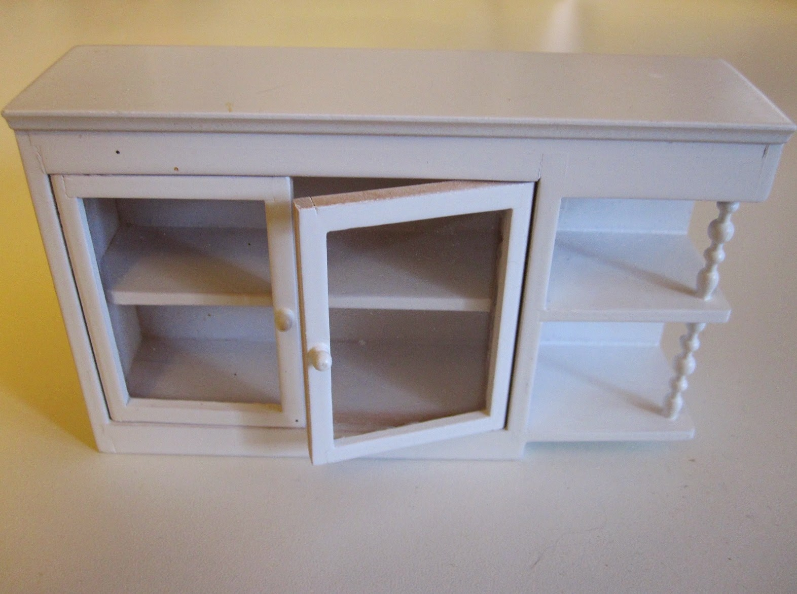 White modern miniature kitchen wall cupboard with display shelf end