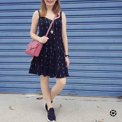 awayfromtheblue Instagram | Kmart Aztec print tiered little black dress with sneakers and pink pop bag rebecca minkoff jean mac