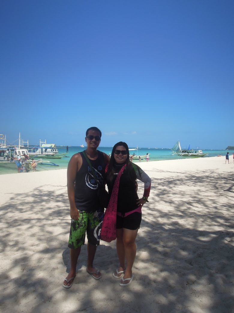 Couple travel bloggers enjoying the beach in Boracay