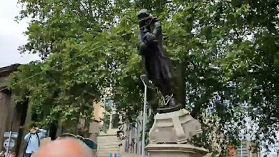 image result for edward colston statue pulled down by black lives matter protesters in bristol