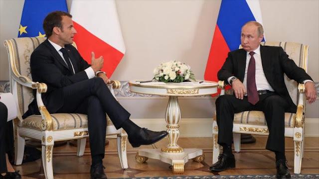 Rusia y Francia apuestan por promover el proceso de paz en Siria