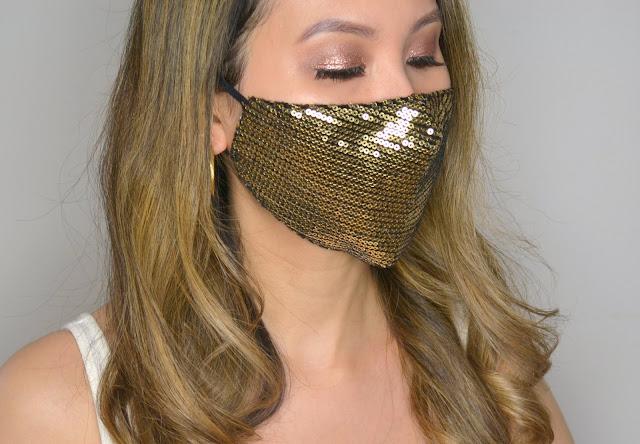 selfie wearing evora cotton face mask in gold