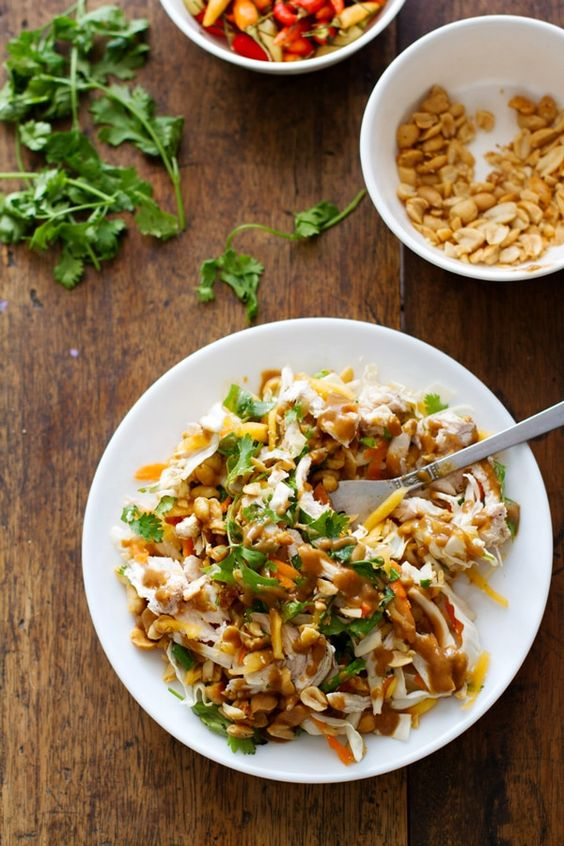This simple chopped Thai chicken salad has incredible flavors - peanut, lime, soy, chili, cilantro. Topped with a homemade dressing. Healthy and fresh. #salad #recipe #cleaneating #healthy