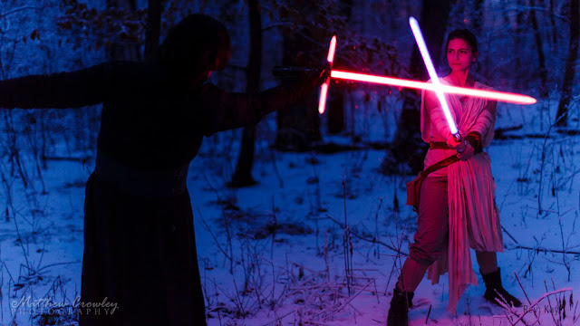 Rey fighting Ren as cosplay