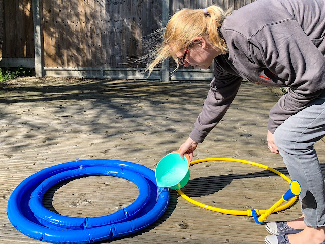 Pouring bubble solution into the mega loop for giant bubbles review