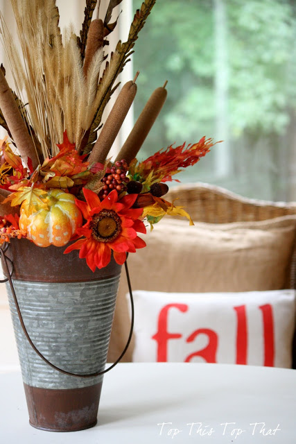 This gorgeous fall centerpiece is a simple DIY from Laura over at Top This Top That