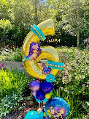 Alexa's 6th Birthday mermaid and Rainbow Fish theme garden decorations by Sue Bowler
