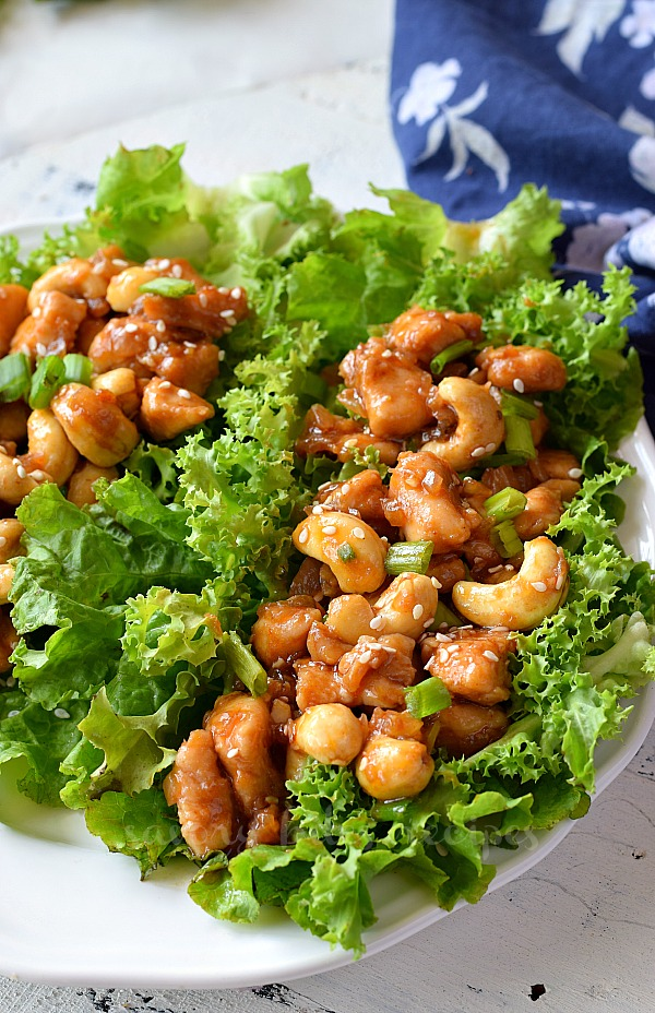 delicious cashew chicken lettuce wraps served on a white plate