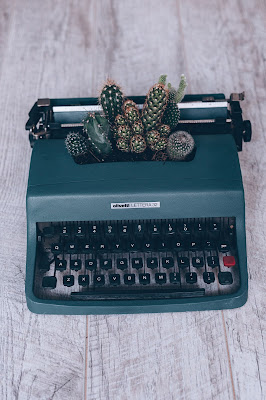 Typewriter with cacti.