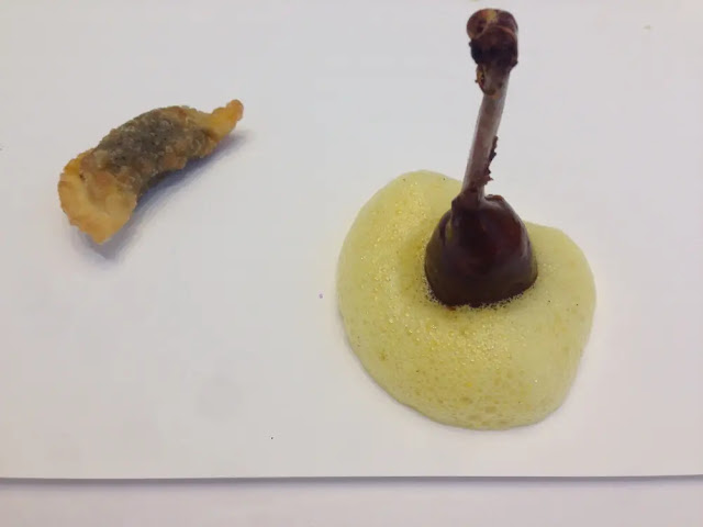 Passion fruit gel and foam with a pigeon thigh with dumplings filled with purple corn fungus cuitlacoche