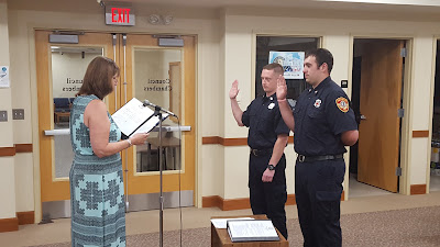 the swearing in of two new fire fighters/emergency medical technicians (EMT)