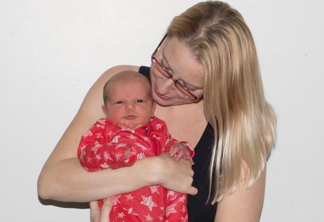 Holding on to newborn baby boy