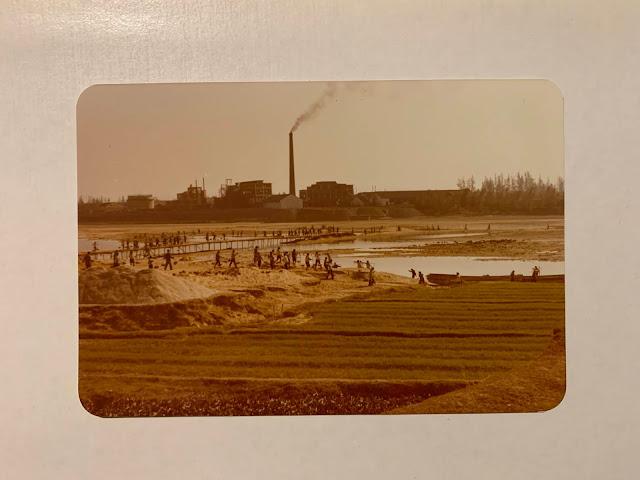Villagers building dam