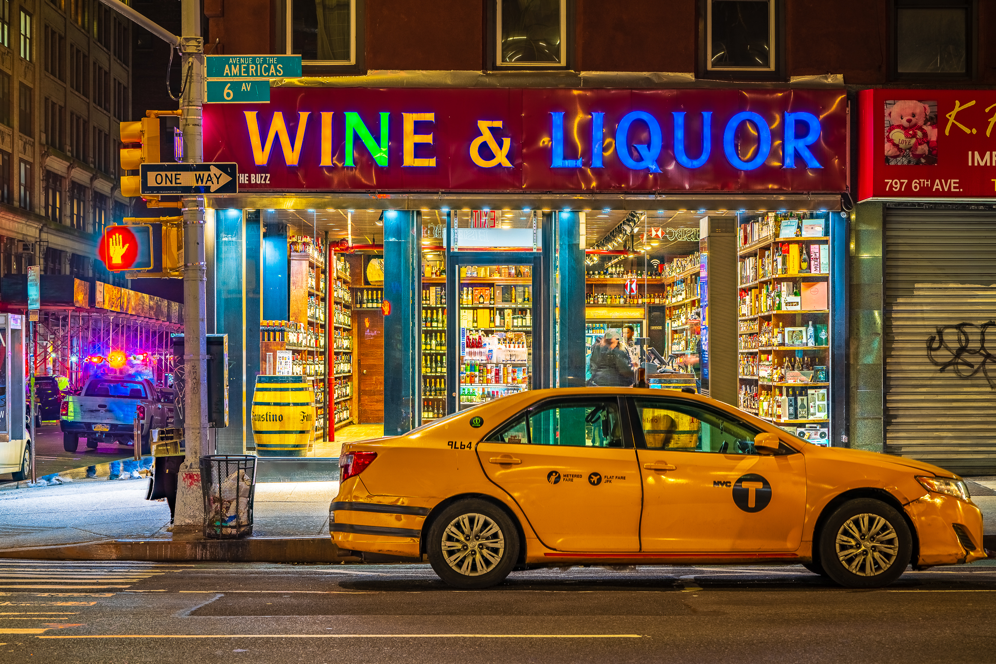 a photo of a taxi cab in front of a liquor store in new york city