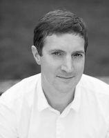 Black and white headshot photo of Kris Dyer.