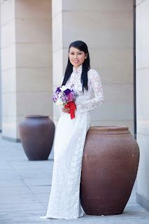 Beautiful girl wearing Vietnamese traditional dress Ao Dai