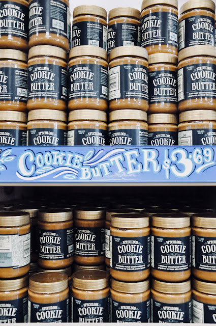 shelf full of cookie butter jars