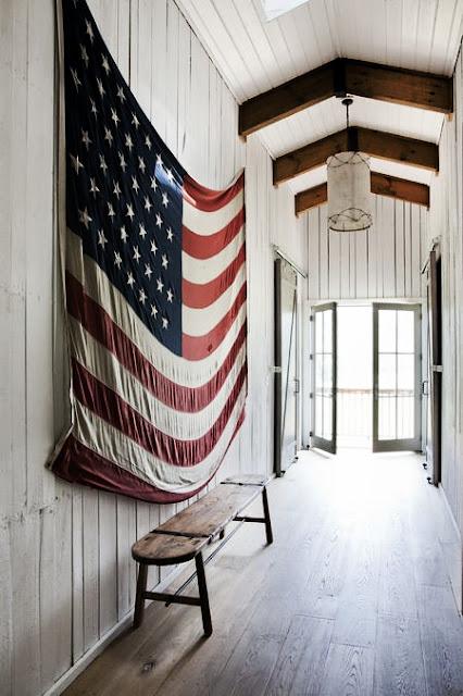 American flag hung on barn wood wall in a farmhouse entry. Rachel Halvorson Inspired Decorating Tips. #americanflag #farmhouse #interiordesign #countrydecor