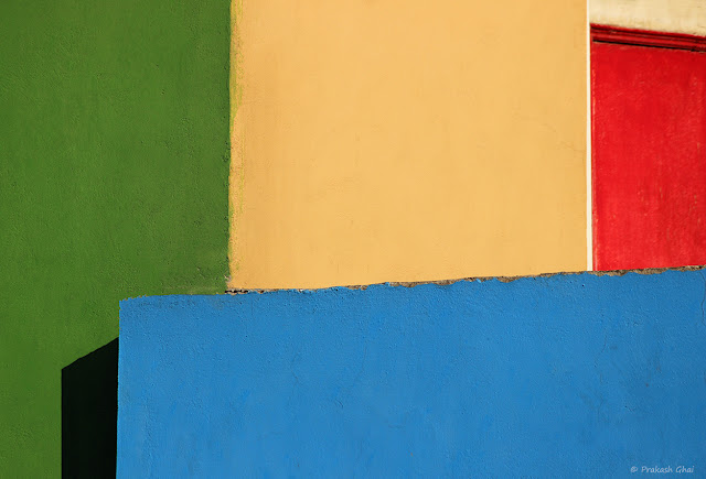 A Minimalist Photograph of a Wall with four different colors.