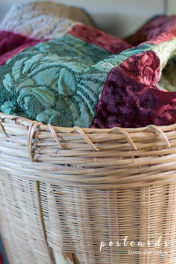 vintage velvet quilt in large woven basket