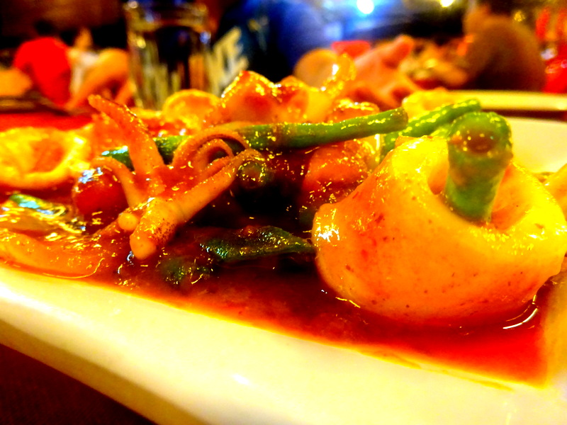 Hot spicy Asam Pedas, which is usually seafood or fish cooked in tamarind juice gravy with chilli and spices.