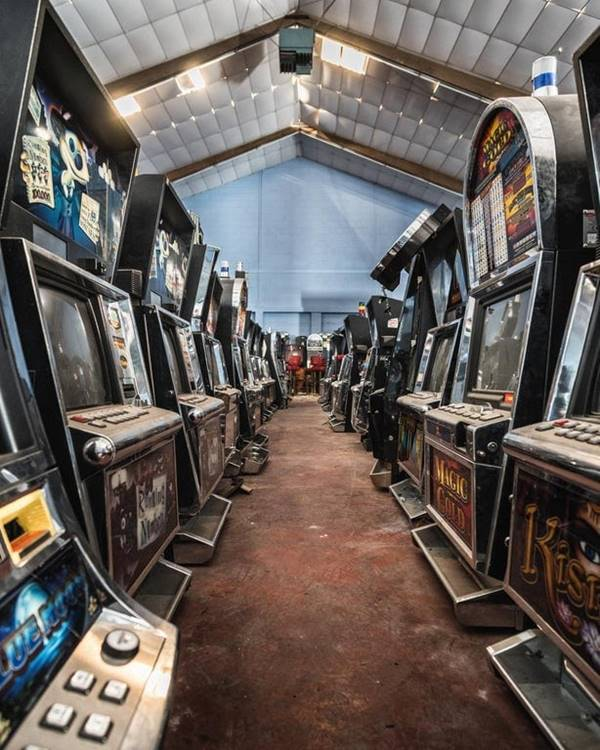 Abandoned warehouse filled with arcade machines