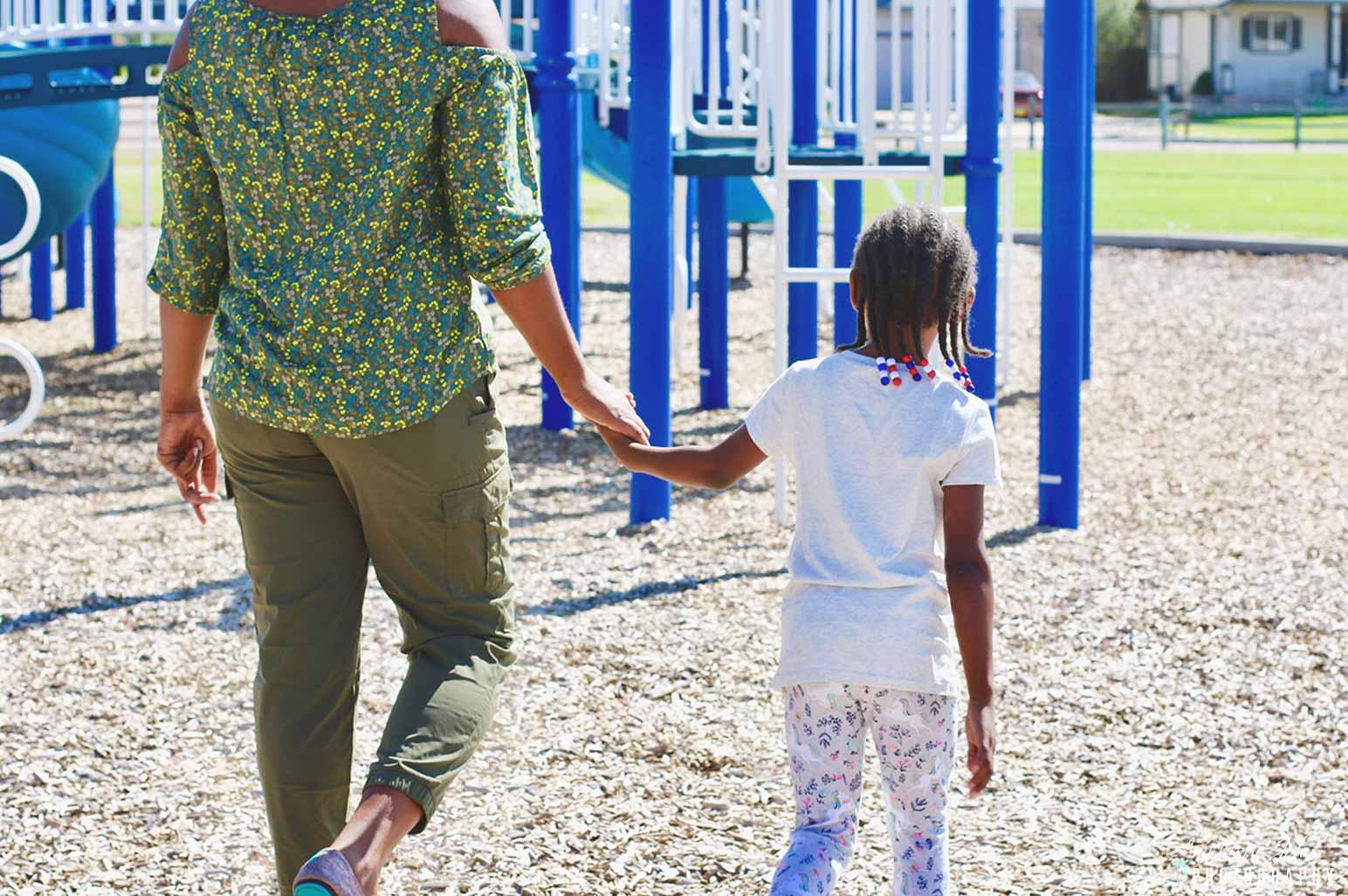 Parenting holding chiild's hand