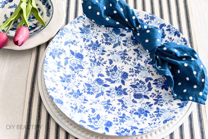 blue and white floral chargers on a Spring table
