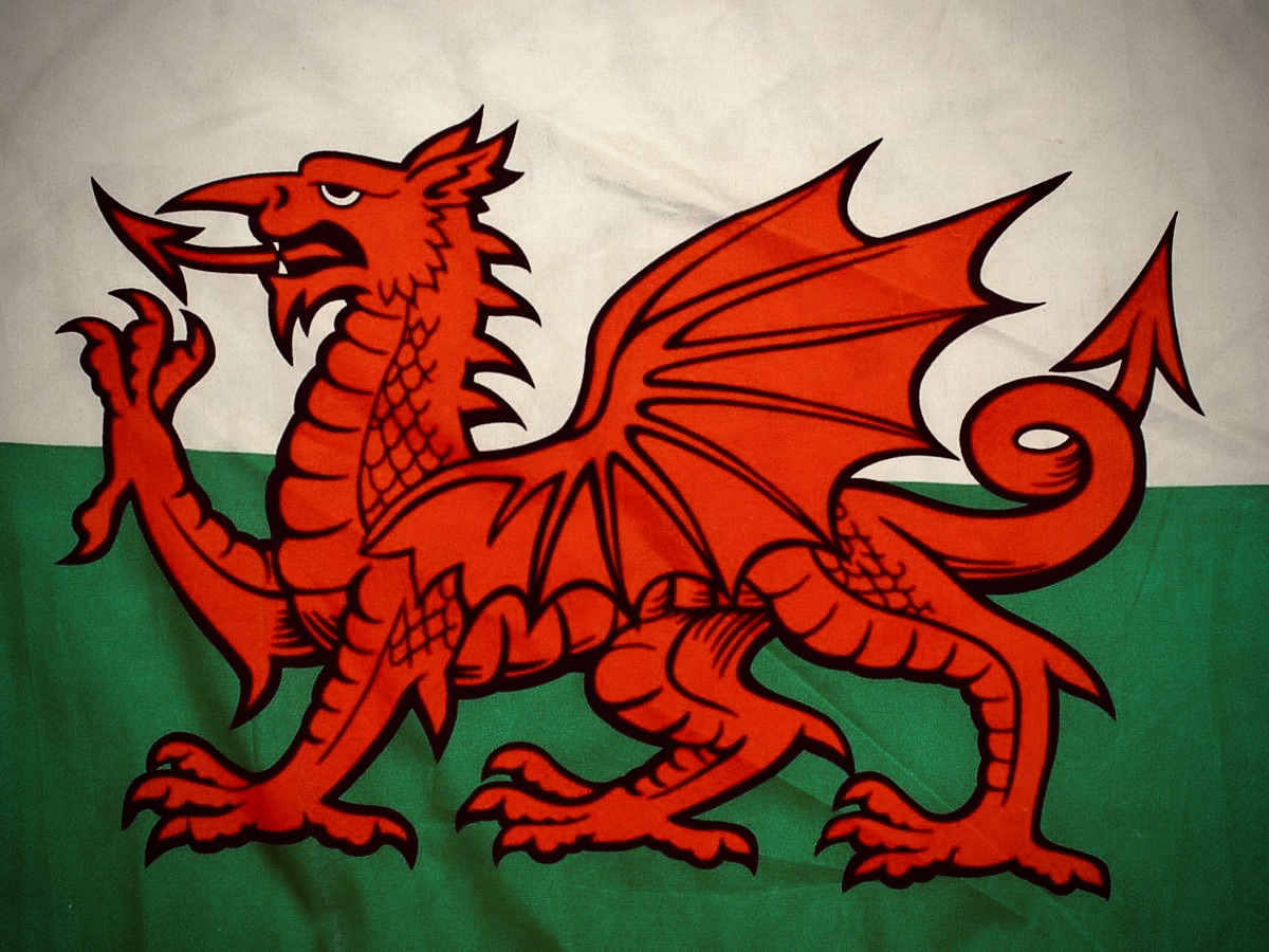 Welsh Flag featuring Red Dragon to centre with green lower and white upper background.