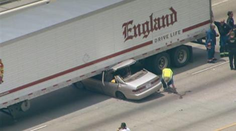 Truck accident on I-45: car stuck under C R  England trailer