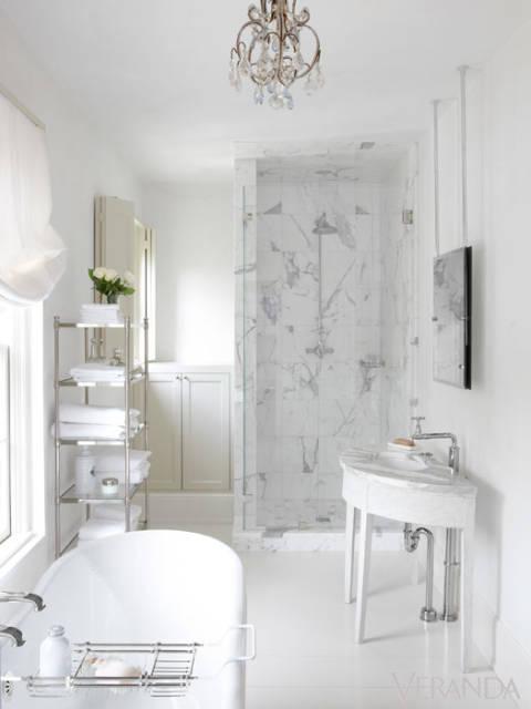 Luxurious white marble Pamela Pierce designed bathroom with elegant finishes and quiet serene palette.