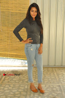 Actress Bhanu Tripathri Pos in Ripped Jeans at Iddari Madhya 18 Movie Pressmeet  0004.JPG