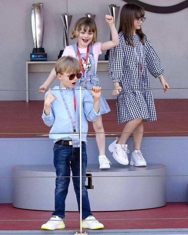Princess Gabriella wore a blue denim daisy duck dress from Monnalisa. Prince Jacques, Pierre Casiraghi and Kaia Rose Wittstock