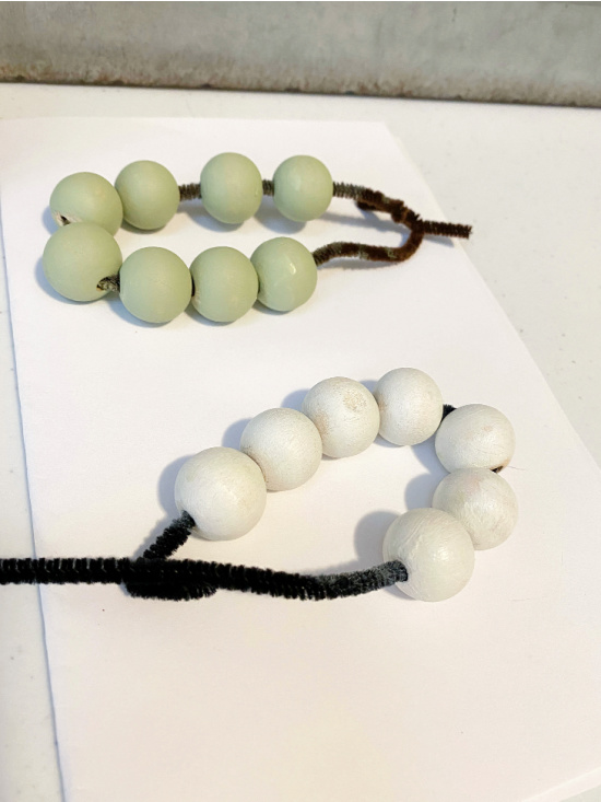 green and white painted beads