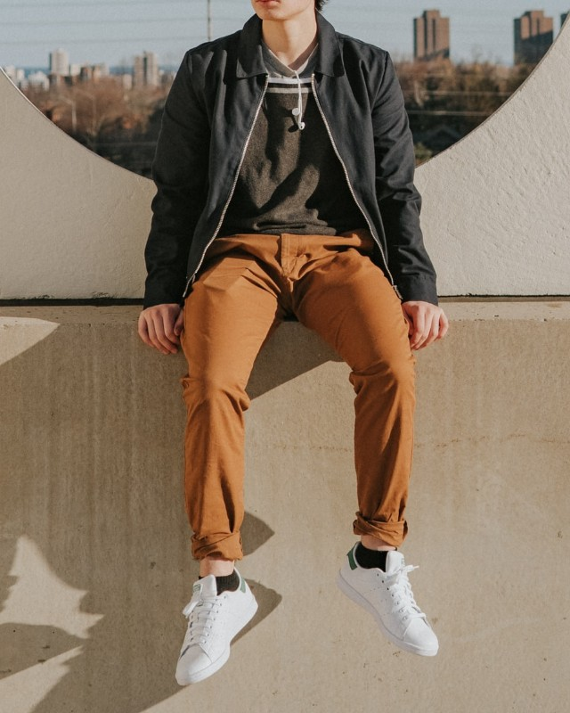Man wearing Track jackets over crew neck tee and stretchable pant.