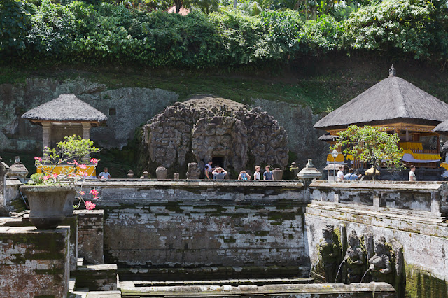 Goa Gajah with people and fountain spouts in ubud bali indonesia