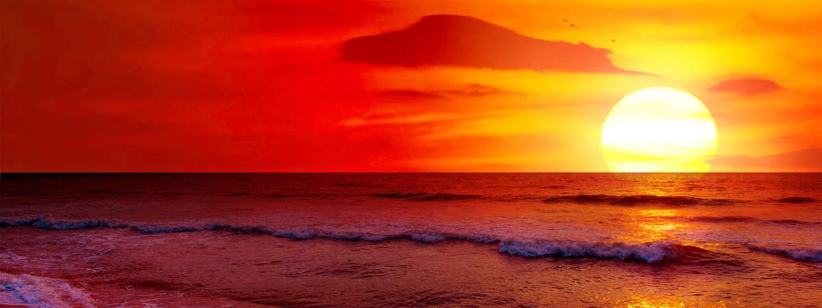 A bright yellow sun dancing on the horizon.