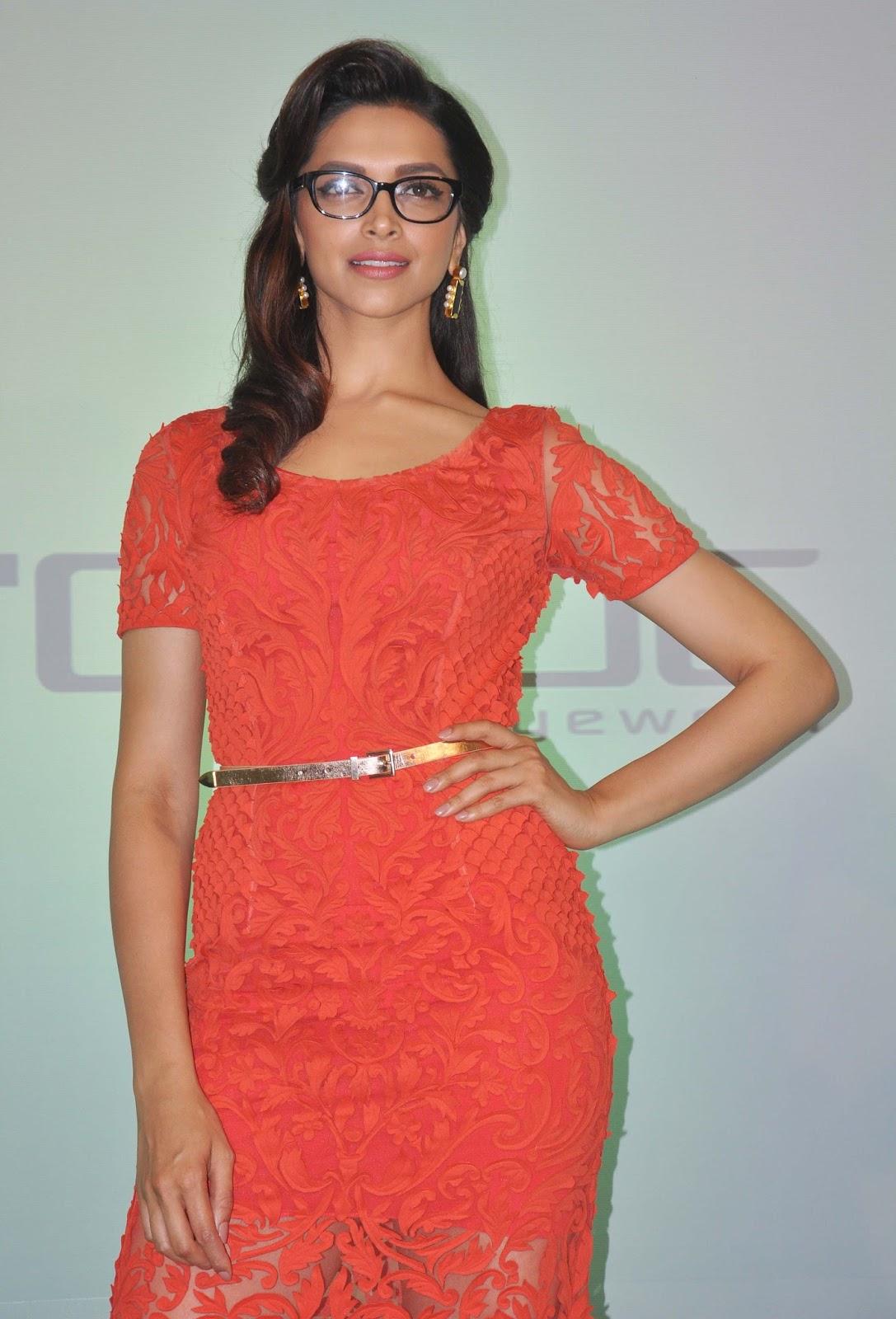 Deepika Padukone Photos In Orange Dress With Glass