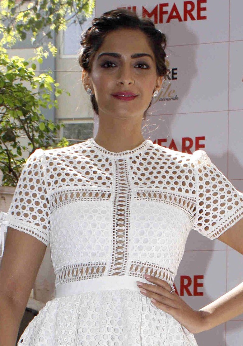 Indian Hot Actress Sonam Kapoor Smiling Face Sizzling Photos In White Dress