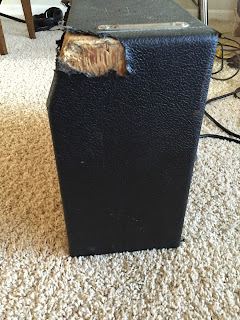 Beat up Fender Champ amp side view